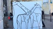 Girafes ou éléphant? Une incroyable illusion d'optique en plein Paris