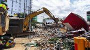 Trois morts et des dizaines de disparus dans l'effondrement d'un immeuble au Cambodge