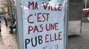 """Action anti-publicité à Liège: """"Ma ville, c'est pas une PUBelle"""""""