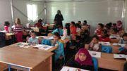 L'enseignement est prioritaire: l'école du camp.