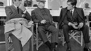 """Lino Ventura, Jean Gabin et Alain Delon sur le tournage du film """"Le Clan des Siciliens"""" en mars 1969 à Rome."""