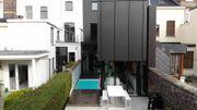 Transformation et extension d'une maison mitoyenne avec piscine à Liège