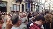 Le rassemblement a commencé par une minute de silence