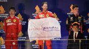"""Vettel """"trempé, mais heureux"""" après sa première victoire de la saison"""
