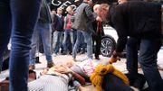 Salon de l'auto: des militants d'Extinction Rebellion s'enchainent aux volants et taguent des voitures avec du sang