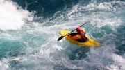Kayaker maneuvers over rough waters