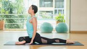 yoga class studio,asian woman master doing Half Pigeon pose,Healthly lifestyle sport