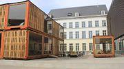 """Le prototype de """"Café Europa"""", au milieu des bâtiments occupés par les équipes de la Fondation Mons 2015"""