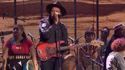 Live joyeux d'Arcade Fire avec des Amérindiens