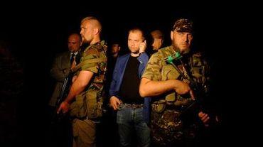 """Le Premier ministre auto-proclamé de la """"République populaire de Donetsk"""", Alexander Borodai à son arrivée sur le lieu du crash de l'avion malaisien le 17 juillet 2014 à Shaktarsk"""