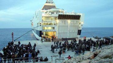 L'Excelsior et des immigrés à Lampedusa
