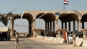 Des membres de la police militaire russe, le 14 août 2018, au poste-frontière de Nassib, dont la réouverture lundi a été  annoncée par la Syrie et la Jordanie