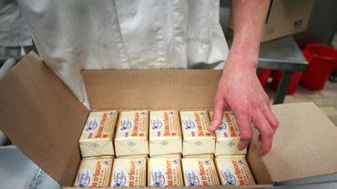 Emballage du beurre à l'usine coopérative d'Isigny-Sainte-Mère à Isigny-sur-Mer (Calvados), le 4 avril 2014
