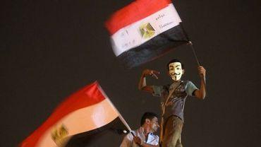 Illustration: des supporters du candidat des Frères musulman Mohamed Morsi défilent place Tahri, au Caire