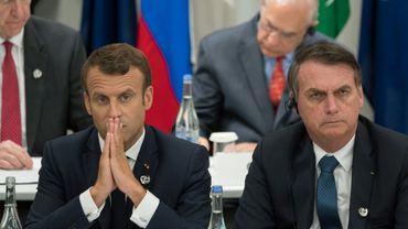 Les présidents français Emmanuel Macron (g) et brésilien Jair Bolsonaro, le 28 juin 2019 au sommet du G20 à Osaka, au Japon