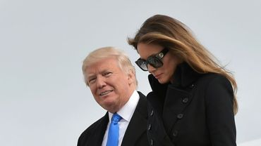 Donald Trump (g) et son épouse Melania, le 19 janvier 2017 sur la base aérienne de Saint Andrews dans le Maryland