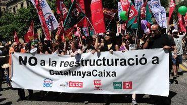 Manifestation contre la restructuration de la banque CatalunyaCaixa, le 6 juillet 2013 à Barcelone