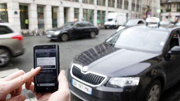 Les chauffeurs Uber ne pourront plus utiliser leur smartphone à Bruxelles (PRESS)