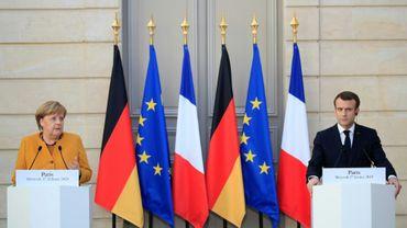 Angela Merkel et Emmanuel Macron donnent une conférence de presse commune à l'Elysée à Paris, le 27 février 2019