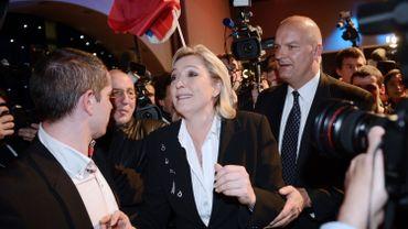 Marine Le Pen en compagnie de son garde du corps, Thierry Légier, soupçonné d'emploi fictif.