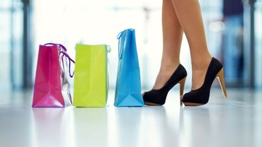 Shopping bags and legs - Stock Image