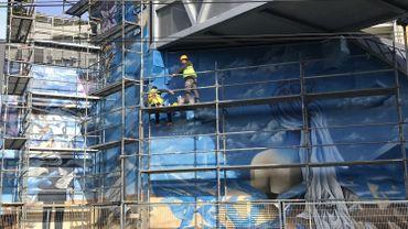 Uccle: des artistes armés de bombes à l'assaut de la gare du Vivier d'Oie