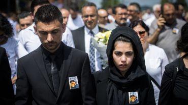 Les parents de Mawda durant l'enterrement de la fillette.