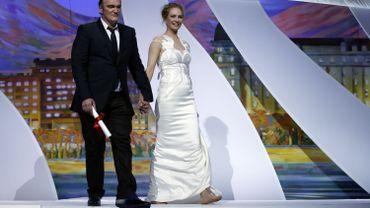 Quentin Tarantino et Uma Thurman montent sur scène pour recevoir leur Palme d'Or