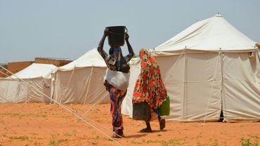 Des personnes déplacées par les inondations, dans un camp à Saguia, près de Niamey, le 11 septembre 2019 au Niger