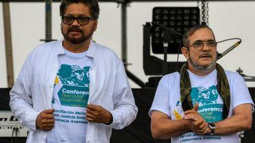 """Deux memebres des Farc, Ivan Marquez et Timoleon Jimenez dit """"Timochenko"""" lors de l'ouverure de la 10e conférence de la guérilla chargée de ratifier la paix, à Caqueta en Colombie le 17 septembre 2016"""
