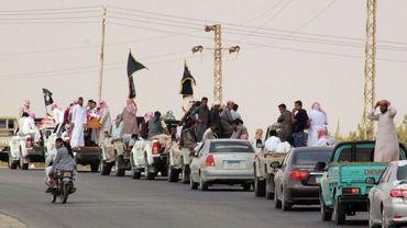 Un convoi funèbre transportent les corps de quatre Égyptiens, militants d'Ansar Beït al-Maqdess, dans le petit village de Sheikh Zuweid le 10 août 2013. Ils avaient, d'après les dires du groupe jihadiste, été tués par des drones israéliens.
