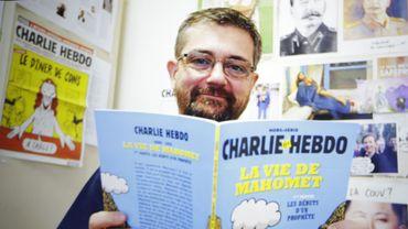 Charb aurait fréquenté des hommes d'affaires originaires du Proche-Orient dans l'espoir d'obtenir de l'argent pour sauver le titre satirique.