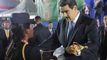 Le président vénézuélien Nicolas Maduro (D) lors d'une cérémonie militaire à Caracas, le 7 juillet 2019