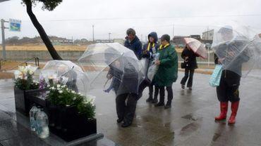 Hommage rendu aux victimes du séisme et tsunami devant un mémorial à Soma (préfecture de Fukushima), le 11 mars 2019,  huit ans après la catastrophe