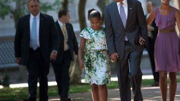 Barack Obama et ses filles Sasha (G) et Malia (D)