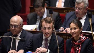 Les ministres français Michel Sapin, Emmanuel Macron et Ségolène Royal à l'Assemblée nationale, à Paris, le 14 octobre 2014