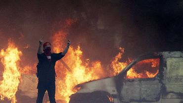 Plusieurs voitures brûlaient dans les rues de Bruxelles, lors de la manifestation nationale