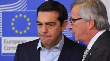 Le Premier ministre grec Alexis Tsipras et le président de la commissiono européenne Jean-Claude Juncker le 13 mars 2015 à Bruxelles