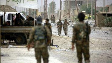 Des combattants des Forces démocratiques syriennes dans un quartier de l'Est de Raqa, lors d'une offensive contre le groupe Etat islamique, le 14 juin 2017