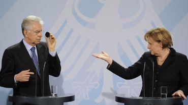Mario Monti Angela Merkel s'emploient à préparer le prochain sommet de la zone euro, avancé au 29 janvier