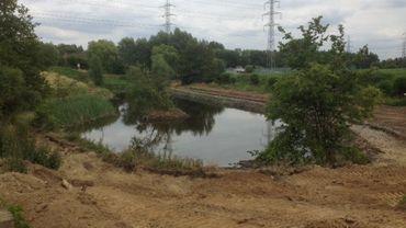 L'un des anciens bassins d'orage qui sera intégré dans le parc actuellement en chantier
