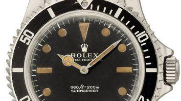 """Des enchères record pour des montres de luxe, dont cette Rolex portée par Roger Moore, alias James Bond, dans """"Vivre et laisser mourir"""""""