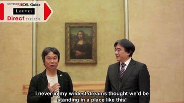 Capture d'écran vidéo de Shigeru Miyamoto et Satoru Iwata devant la Joconde