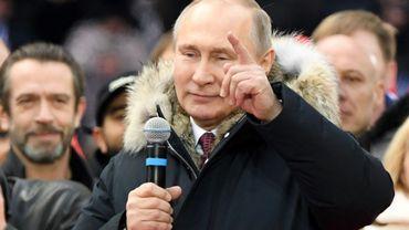 Le président russe Vladimir Poutine, candidat à la présidentielle, lors d'un meeting de campagne, le 3 mars 2018 à Moscou