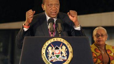 Le président du Kenya Uhuru Kenyatta (G) lors d'un discours après les élections le 11 août 2017 à Nairobi