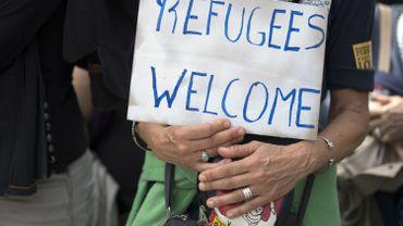 """Un portefeuille """"refugees welcome"""" en soutien aux journalistes poursuivies pour trafic d'être humains"""