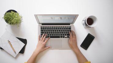 Womans hands using laptop