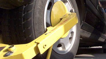 Un sabot pour immobiliser la roue