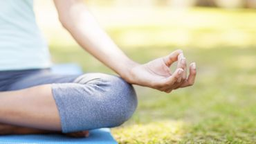 Close-up Of Woman Practicing Yoga In Lotus Position