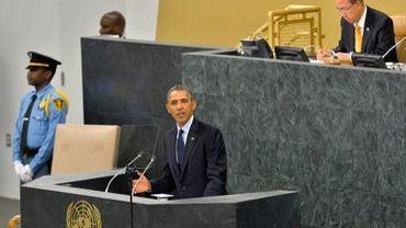 Barack Obama (c) et le secrétaire général de l'ONU Ban Ki-moon (d) à New York, le 24 septembre 2013